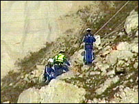 Coastguard teams retrieve the bodies at Beachy Head - picture courtesy of RNLI