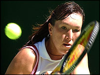 Jelena Jankovic plays a backhand during her win over Elena Dementieva