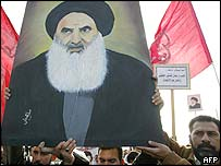 Shia protesters hold up a portrait of Ayatollah Sistani as they march through Baghdad, 19 January 2004