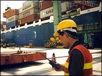 A worker loading containers at Yantian Port, Shenzhen
