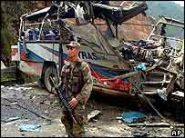 Soldier and wrecked bus   AP