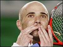 Andre Agassi salutes the Melbourne crowd after his first-round victory