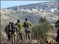 Israeli soldiers look across border into Lebanon