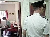 Prison officer and prisoner
