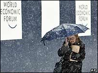 A delegate fights swirling blizzards at Davos