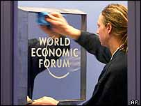 An WEF employee cleans a sign