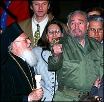Patriarch Bartholomew l (left) is greeted by Fidel Castro (right)