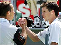 Henman and Stepanek shake hands at the end of the match