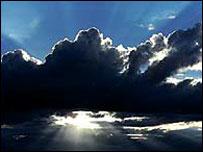 Sun shining through clouds   1999 Eyewire, Inc.