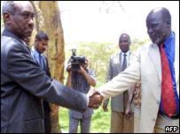 Ali Osman Taha(l) and John Garang (r)