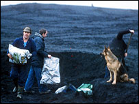 Miners picking coal from a tip