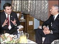 Mikhail Saakashvili talks to Colin Powell