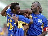 Alain Masudi celebrates with his team mates