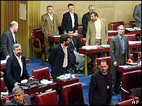 Iranian lawmakers in stand to pass a vote in parliament