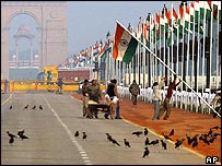 Workers erect flag for Republic Day in Delhi