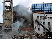 Smoke rises from the bombed Serbian state television station, 23 April 1999