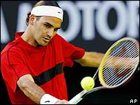 Roger Federer plays a backhand in his match against Lleyton Hewitt