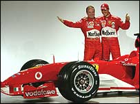 Rubens Barrichello and Michael Schumacher pose with the new Formula One Ferrari