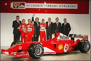 Ferrari team principles and drivers pose with the F2004