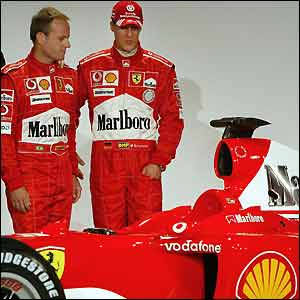 Barrichello and Schumi eye up the F2004