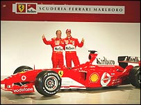 Rubens Barrichello and Michael Schumacher pose with the new Ferrari