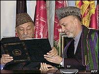 Hamid Karzai [R] with former king Zahir Shah