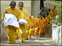 Nuns carrying food