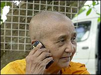 Bhikuni Kusuma on her phone