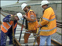 A crew works on a railway line