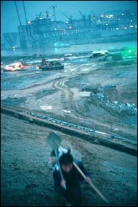 A worker returning home after a day's work at the Three Gorges Dam