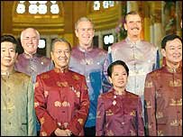 APEC leaders pose in Bangkok last year