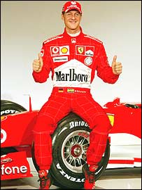 Michael Schumacher poses with his new Ferrari