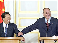 Chinese President Hu Jintao (left) and his French counterpart Jacques Chirac share a laughter during a joint press conference  in Paris