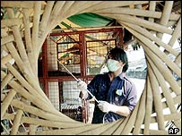 Thai livestock official sprays empty poultry cages