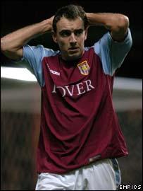 Aston Villa midfielder Gavin McCann sees red