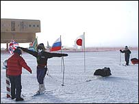 Fiona and Mike Thornewill hug at the South Pole (photo courtesy of Scot Jackson)