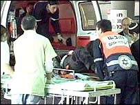Injured person being lifted into ambulance