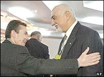Pere Miro, left, congratulates Ahmed al-Samarrai