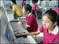 Students use the internet at a computer room in western China