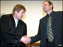 Armin Meiwes (R) shakes hand of his defence lawyer Harald Ermel