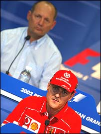 Ron Dennis and Michael Schumacher at a news conference last year