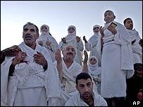 Muslim pilgrims pray on Mount Arafat near Mecca