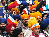 Sikhs, some holding the French flag, demonstrate in Paris