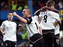 Fulham celebrate Brian McBride's winner.