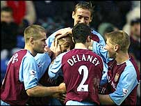Villa players celebrate.