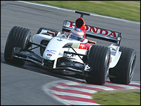 Jenson Button behind the wheel of the new BAR-Honda at its launch on Sunday