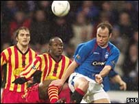 Jean Yves Anis tries to stop Rangers' Christian Nerlinger