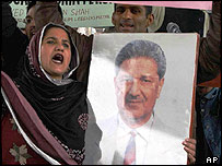 Protester in Pakistan with portrait of Abdul Qadeer Khan