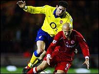 Arsenal defender Martin Keown brings down Middlesbrough striker Massimo Maccarone