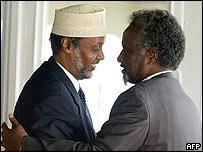 Interim Somali President Abdul Kassim Salat hugs faction leader Mohammed Omar Habed